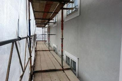 Fasadrenovering och intäckning vintertid.